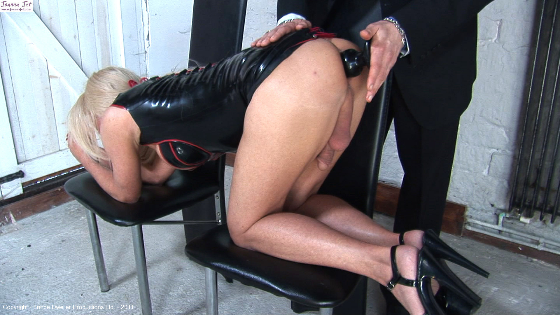 Tranny in short rubber movie